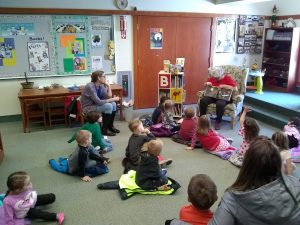 Ms. Carrie reading to Pre-schoolers